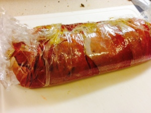 Roll up the stretch film over the beef. Let it sit in the fridge for about 30 minutes.
